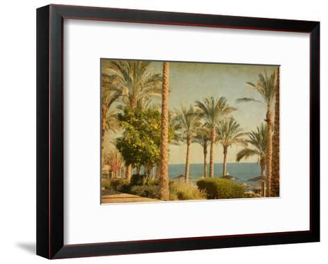 Retro Image Of Beach With Date Palms Amid The Blue Sea And Sky. Paper Texture-A_nella-Framed Art Print