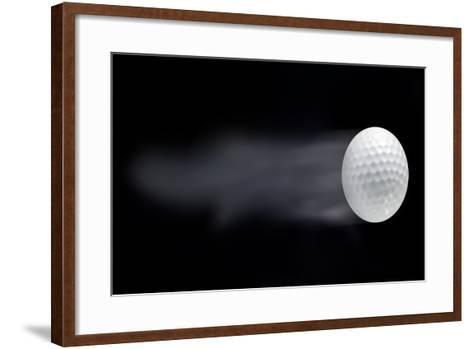 Golf Ball Leaving Trails Behind On Black Background--Framed Art Print
