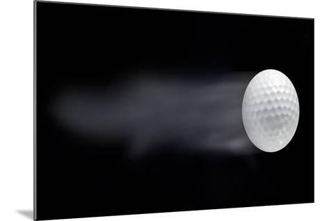 Golf Ball Leaving Trails Behind On Black Background--Mounted Art Print