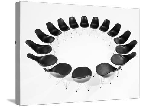 Black Chairs In A Circle Isolated On White Background-gemenacom-Stretched Canvas Print