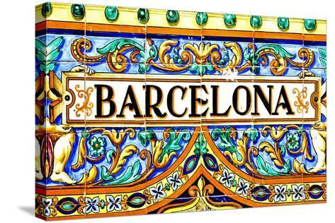A Barcelona Sign Over A Mosaic Wall-nito-Stretched Canvas Print