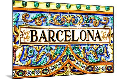 A Barcelona Sign Over A Mosaic Wall-nito-Mounted Art Print