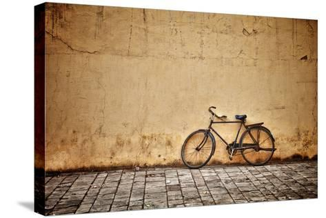 Old Vintage Bicycle Near The Wall-pzAxe-Stretched Canvas Print