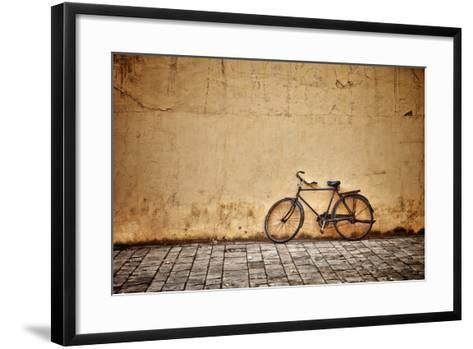 Old Vintage Bicycle Near The Wall-pzAxe-Framed Art Print
