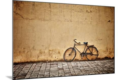 Old Vintage Bicycle Near The Wall-pzAxe-Mounted Art Print