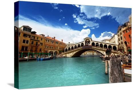 Rialto Bridge In Venice, Italy-Iakov Kalinin-Stretched Canvas Print