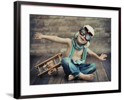 A Small Boy Playing-conrado-Framed Art Print