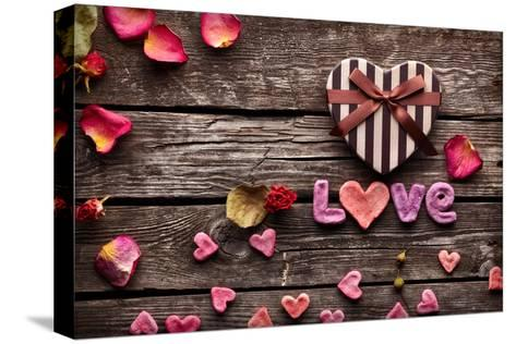 Word Love With Heart Shaped Valentines Day Gift Box On Old Vintage Wooden Plates-ouh_desire-Stretched Canvas Print