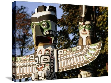 Two Totem Poles, Stanley Park, Vancouver, British Columbia, Canada-Walter Bibikow-Stretched Canvas Print