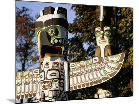 Two Totem Poles, Stanley Park, Vancouver, British Columbia, Canada-Walter Bibikow-Mounted Photographic Print