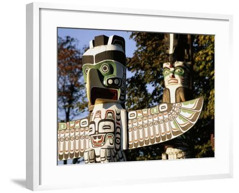 Two Totem Poles, Stanley Park, Vancouver, British Columbia, Canada-Walter Bibikow-Framed Art Print