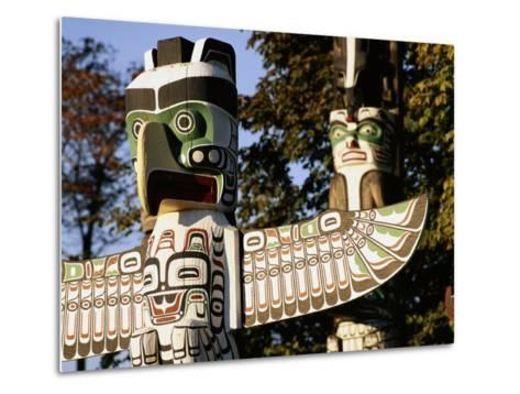 Two Totem Poles, Stanley Park, Vancouver, British Columbia, Canada-Walter Bibikow-Metal Print