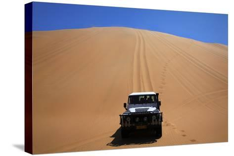 Car Descending a Sand Dune, Namib-Naukluft National Park, Namibia-David Wall-Stretched Canvas Print