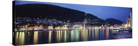 View from Harbor at Night, Bryggen, Hordaland, Norway-Walter Bibikow-Stretched Canvas Print