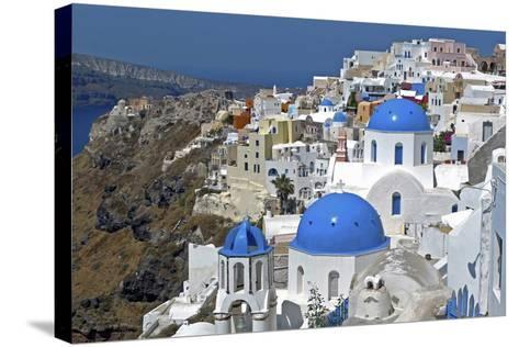 The Town of Oia on the Island of Santorini, Greece-David Noyes-Stretched Canvas Print