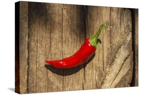 Red Pepper on Wooden Table, Yesemek, Gaziantep, Turkey-Ali Kabas-Stretched Canvas Print
