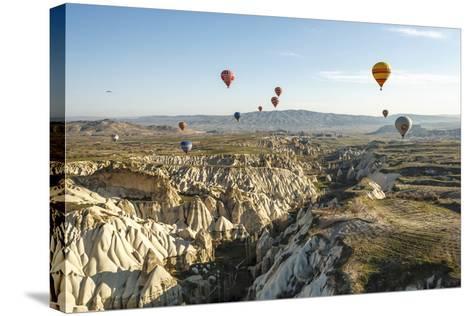 Aerial View of Hot Air Balloons, Cappadocia, Central Anatolia, Turkey-Ali Kabas-Stretched Canvas Print