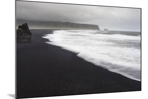 Basalt Column Rises from Black Sand Beach on Rainy Day, Vik, Iceland-Jaynes Gallery-Mounted Photographic Print