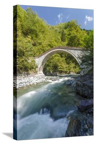 River and Stone Bridge, Rize, Black Sea Region of Turkey-Ali Kabas-Stretched Canvas Print