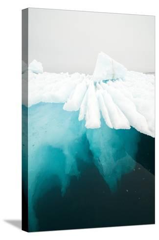 Glacial Iceberg Floating Along Coast, Spitsbergen, Svalbard, Norway-Steve Kazlowski-Stretched Canvas Print