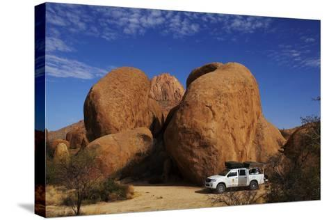 4X4 and Campsite Beside Giant Boulders at Spitzkoppe, Namibia-David Wall-Stretched Canvas Print