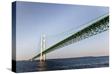 Sailing under the Mackinac Bridge in Mackinac Island, Michigan, USA-Joe Restuccia III-Stretched Canvas Print