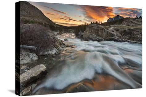 Sunrise Clouds over Swiftcurrent Falls, Glacier NP, Montana, USA-Chuck Haney-Stretched Canvas Print