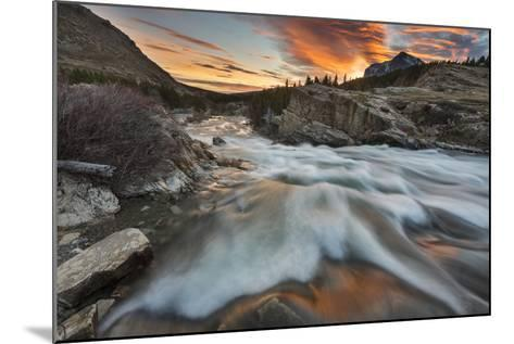 Sunrise Clouds over Swiftcurrent Falls, Glacier NP, Montana, USA-Chuck Haney-Mounted Photographic Print