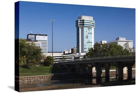Skyline by the Arkansas River, Wichita, Kansas, USA-Walter Bibikow-Stretched Canvas Print