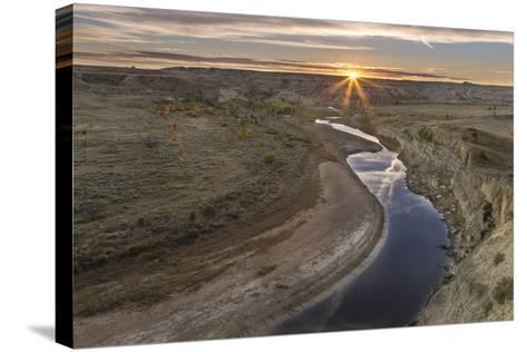 Sunset over the Little Missouri River, North Dakota, USA-Chuck Haney-Stretched Canvas Print