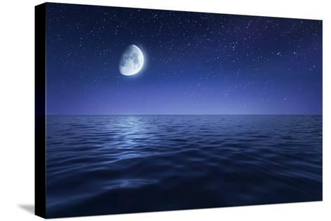 Tranquil Seas Against Rising Moon in a Starry Sky, Crete, Greece--Stretched Canvas Print