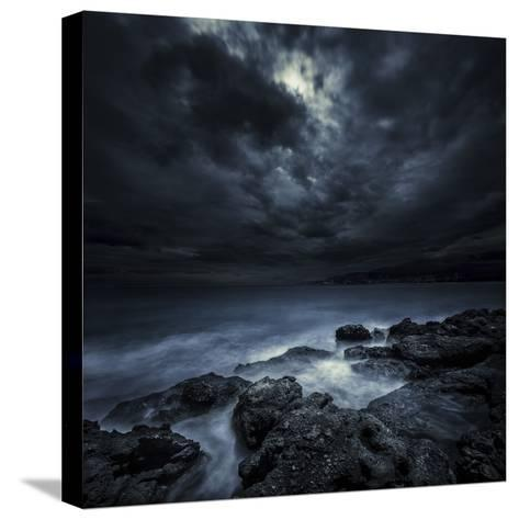 Black Rocks Protruding Through Rough Seas with Stormy Clouds, Crete, Greece--Stretched Canvas Print