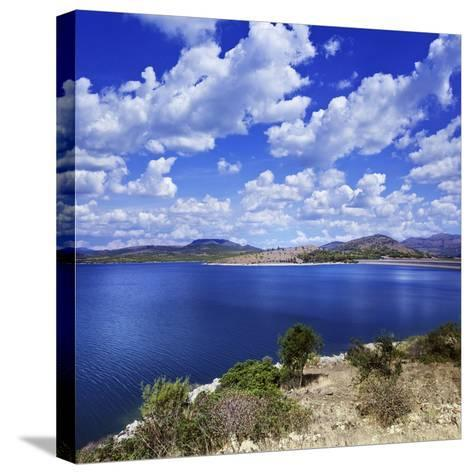 Tranquil Lake Against Cloudy Sky, Sardinia, Italy--Stretched Canvas Print