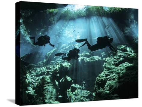 Diver Enters the Cavern System in the Riviera Maya Area of Mexico--Stretched Canvas Print