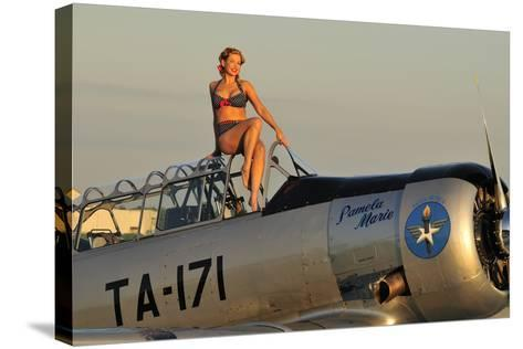1940's Style Pin-Up Girl Sitting on the Cockpit of a World War II T-6 Texan--Stretched Canvas Print