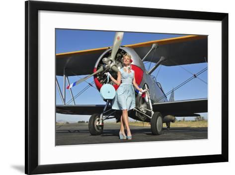Elegant 1940's Style Pin-Up Girl Standing in Front of an F3F Biplane--Framed Art Print