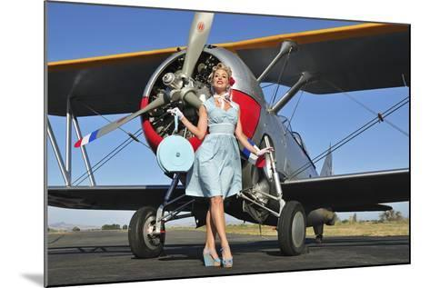 Elegant 1940's Style Pin-Up Girl Standing in Front of an F3F Biplane--Mounted Photographic Print