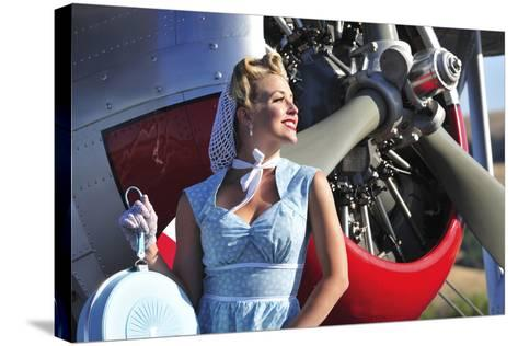 Close-Up of a 1940's Style Pin-Up Girl in Front of a Vintage F3F Biplane--Stretched Canvas Print