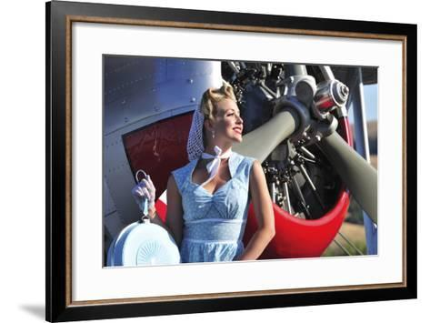 Close-Up of a 1940's Style Pin-Up Girl in Front of a Vintage F3F Biplane--Framed Art Print