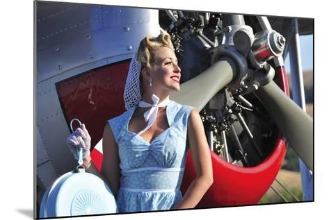 Close-Up of a 1940's Style Pin-Up Girl in Front of a Vintage F3F Biplane--Mounted Photographic Print