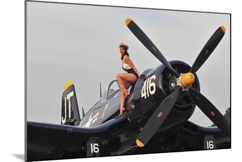 1940's Style Navy Pin-Up Girl Sitting on a Vintage Corsair Fighter Plane--Mounted Photographic Print