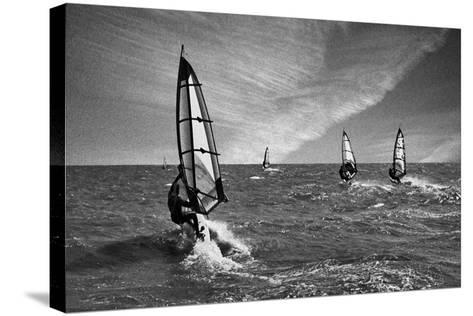 Racing Surfers-Adrian Campfield-Stretched Canvas Print