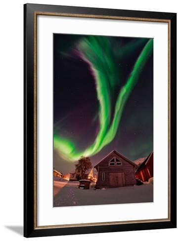 The Aurora Borealis, or Northern Lights, Appear Above a Village-Babak Tafreshi-Framed Art Print