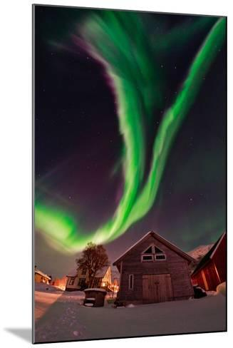 The Aurora Borealis, or Northern Lights, Appear Above a Village-Babak Tafreshi-Mounted Photographic Print