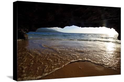The Lip of a Foamy Wave Laps a Sandy Beach Inside an Ocean Cave-Jason Edwards-Stretched Canvas Print