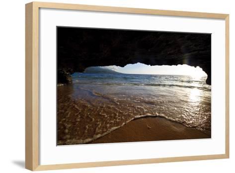 The Lip of a Foamy Wave Laps a Sandy Beach Inside an Ocean Cave-Jason Edwards-Framed Art Print