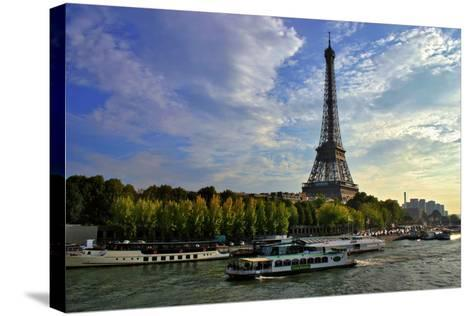 A Scenic View of the Eiffel Tower and a Ferry in the Seine River-Babak Tafreshi-Stretched Canvas Print