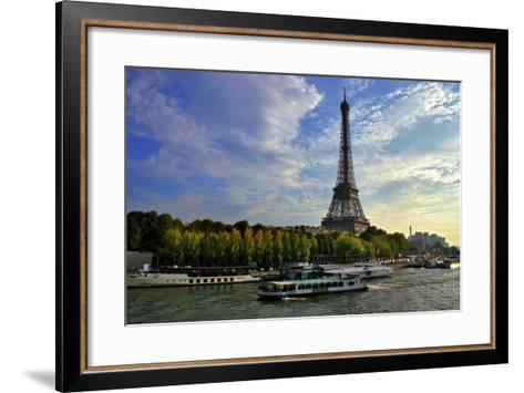 A Scenic View of the Eiffel Tower and a Ferry in the Seine River-Babak Tafreshi-Framed Art Print