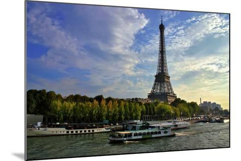 A Scenic View of the Eiffel Tower and a Ferry in the Seine River-Babak Tafreshi-Mounted Photographic Print