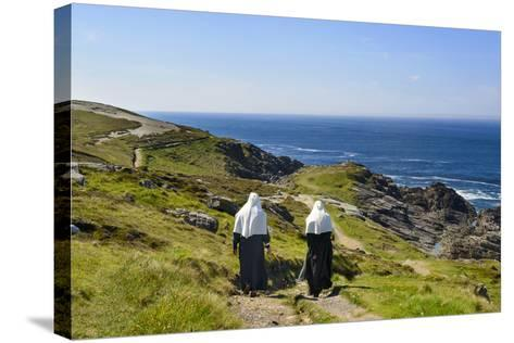 Two Nuns Walking on a Beach in Ireland-Chris Hill-Stretched Canvas Print